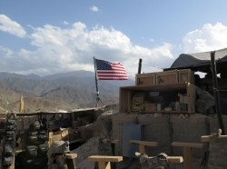 A U.S. flag is seen at a post in Deh Bala district, Nangarhar province, Afghanistan, after U.S. and Afghan forces cleared Islamic State fighters from the area, July 7, 2018