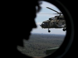 A Russian Mi-8 military helicopter is seen through a window while flying during a rehearsal for the Navy Day parade in Saint Petersburg, Russia, July 21, 2019, photo by Anton Vaganov/Reuters
