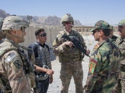 U.S. advisors speak with their Afghan National Army counterparts during a routine fly-to-advise mission at Forward Operating Base Altimur, Afghanistan, September 19, 2018, photo by Sean Kimmons/U.S. Army