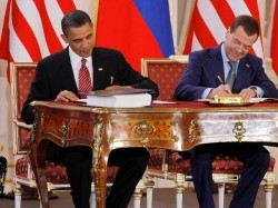 U.S. President Barack Obama and Russian President Dmitry Medvedev sign the New Strategic Arms Reduction Treaty at Prague Castle in the Czech Republic, April 8, 2010, photo by Jason Reed/Reuters