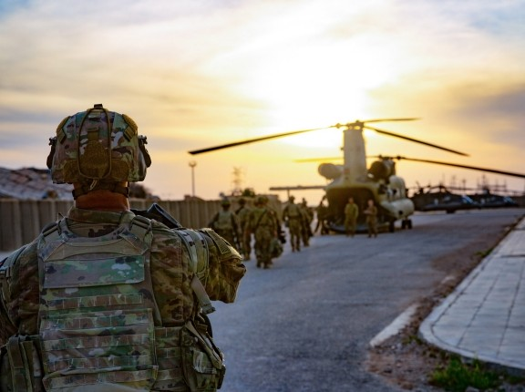 U.S. soldiers load onto a CH-47 Chinook helicopter as they leave Al Qaim Base, Iraq, March 9, 2020, photo by Spc. Andrew Garcia/U.S. Army