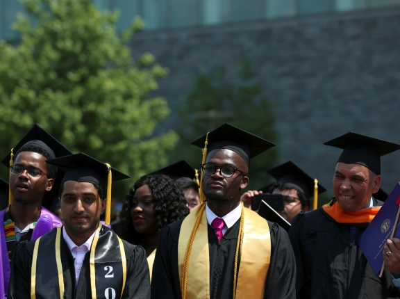 Graduates of The City College of New York stand at their commencement ceremony in Manhattan on May 31, 2019, photo by Gabriela Bhaskar/Reuters