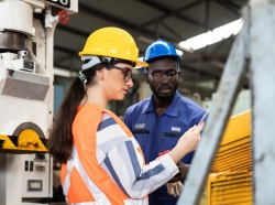African American male and female industrial engineering in safety uniform, photo by amorn/AdobeStock
