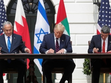 Israel's Prime Minister Benjamin Netanyahu, U.S. President Donald Trump, and UAE Foreign Minister Abdullah bin Zayed sign the Abraham Accords in Washington, September 15, 2020, photo by Tom Brenner/Reuters