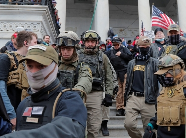 Jessica Marie Watkins (second from left) and Donovan Ray Crowl (center), both U.S. veterans who have since been indicted for their roles in the Capitol riot, in Washington, D.C., January 6, 2021, photo by Jim Bourg/Reuters