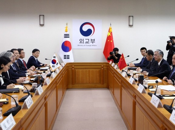 South Korea's Foreign Minister Kang Kyung-wha talks with Chinese Foreign Minister Wang Yi during a meeting in Seoul, December 04, 2019, photo by Chung Sung-Jun/Pool via Reuters