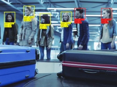 Facial recognition technology being used in an airport, photo by izusek/Getty Images