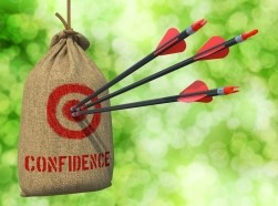 Arrows hitting a red target with the word 'confidence'