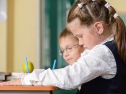 two children working at desks