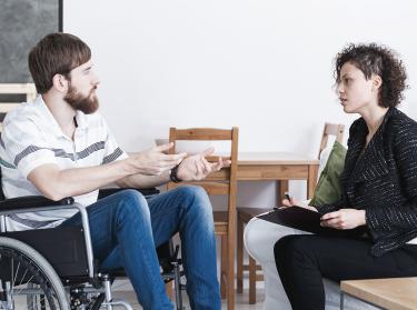 A veteran talks to a counselor