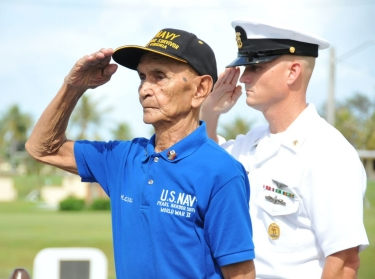 World War II veteran Manuel Diaz and Joint Region Marianas Command Master Chief Paul Kingsbury at a ceremony commemorating the 69th anniversary of the Battle of Midway