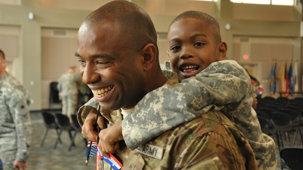 Georgia Army National Guard Capt. Chad Tyson receives a hug from son Chase during a welcome home ceremony