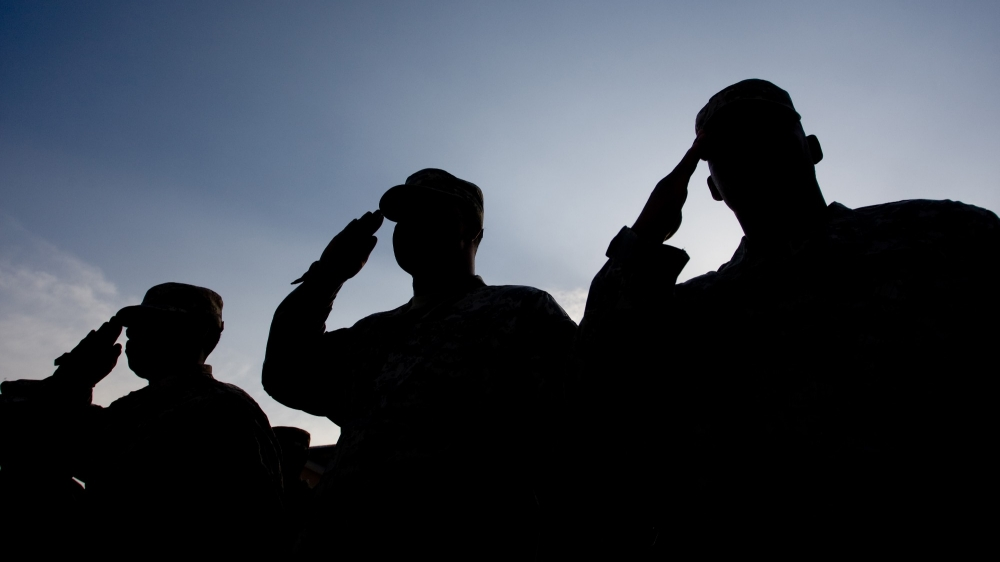 Soldiers salute at dawn