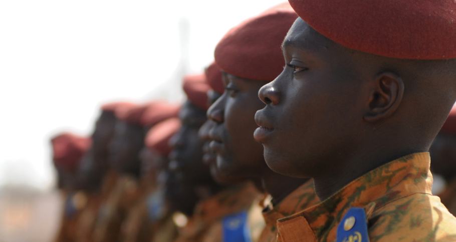 Soldiers of the Burkina Faso Army stand at attention at Camp Zagre, Burkina Faso, on February 27, 2017, at the opening of Flintlock 2017. The annual exercise, sponsored by the U.S. Africa Command, aims to strengthen security institutions, promote multilateral information sharing, and develop interoperability among partner nations in the Trans-Sahara region.