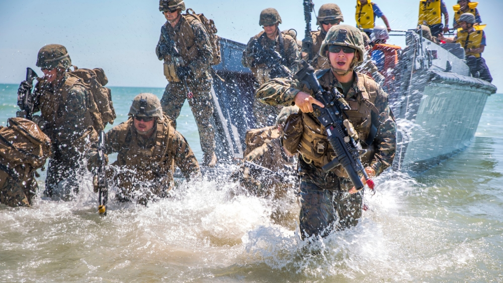 Marines assault a beach using a landing boat during an exercise in Ukraine, July 19, 2017.