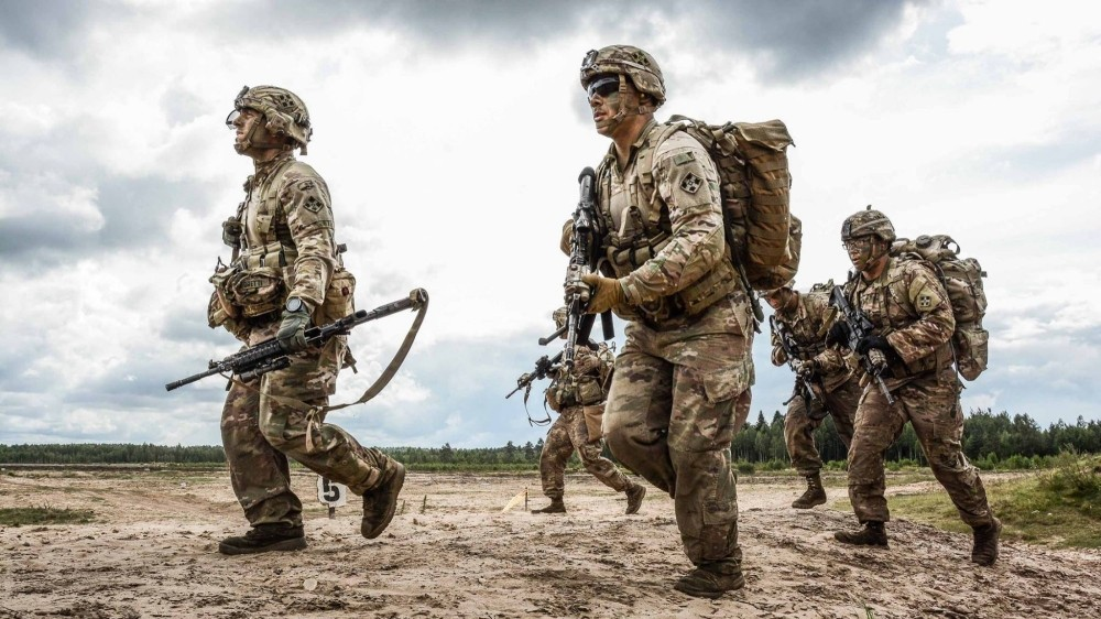 Riflemen with Chosen Co., 1st Battalion, 66th Armor Regiment, 3rd Armored Brigade Combat Team, 4th Infantry Division, compete in the Lithuanian Best Infantry Squad Competition at Rukla Training Area, Lithuania, Aug. 24, 2017.