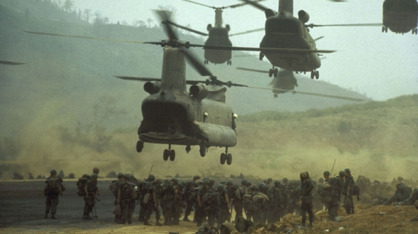 CH-47 Boeing Chinook transport helicopters taking off after deploying ground troops along area known as Route Nine for an offensive patrol, 1968.