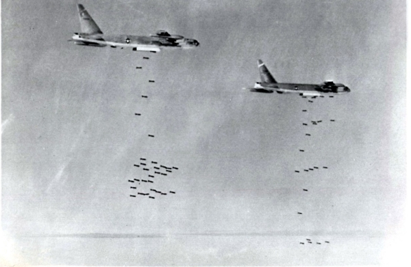 "Jul 7, 1965, 28 B-52s dropped over 540 tons of 750 and 1,000-pound bombs on a Viet Cong staging and training area known as Zone ""D."""