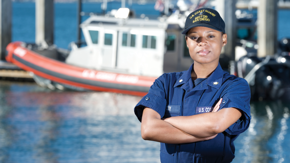 A U.S. Coast Guard by the water.