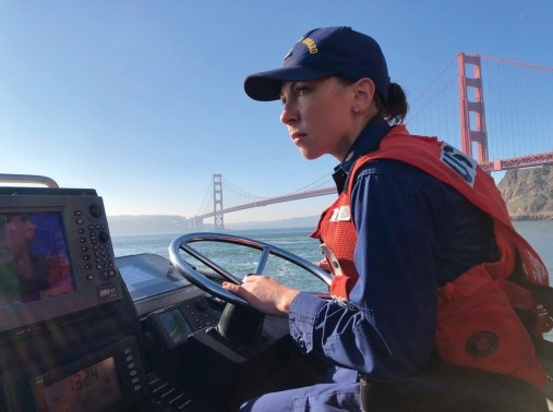 Petty Officer 1st Class Krystyna Duffy drives a 47-foot Motor Lifeboat near the Golden Gate Bridge, February 8, 2018