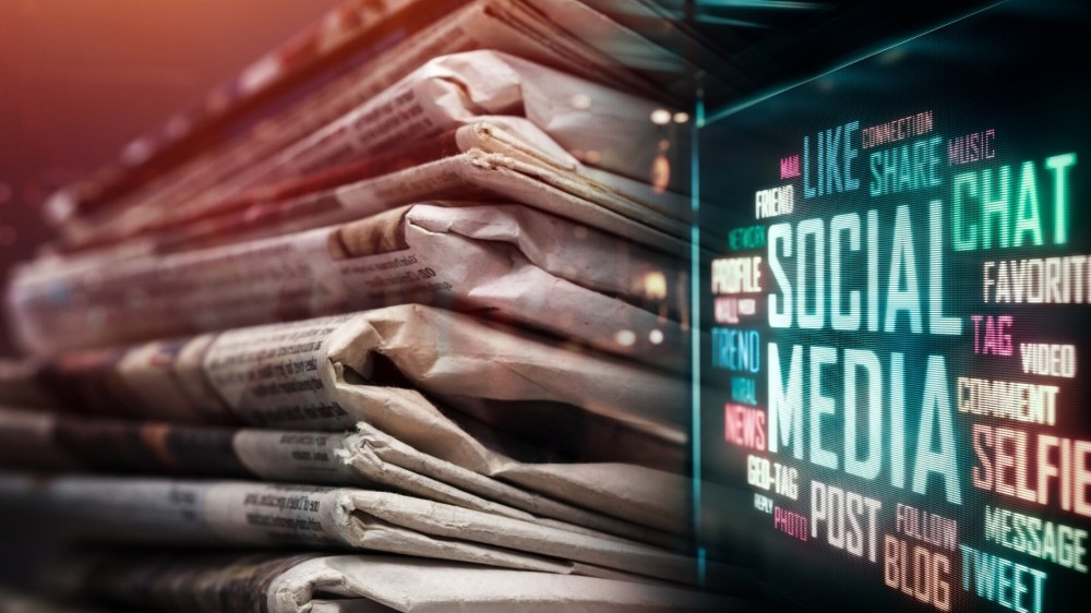 Newspapers and social media terms in LED display, photos by artisteer/Getty Images and phive2015/Adobe Stock