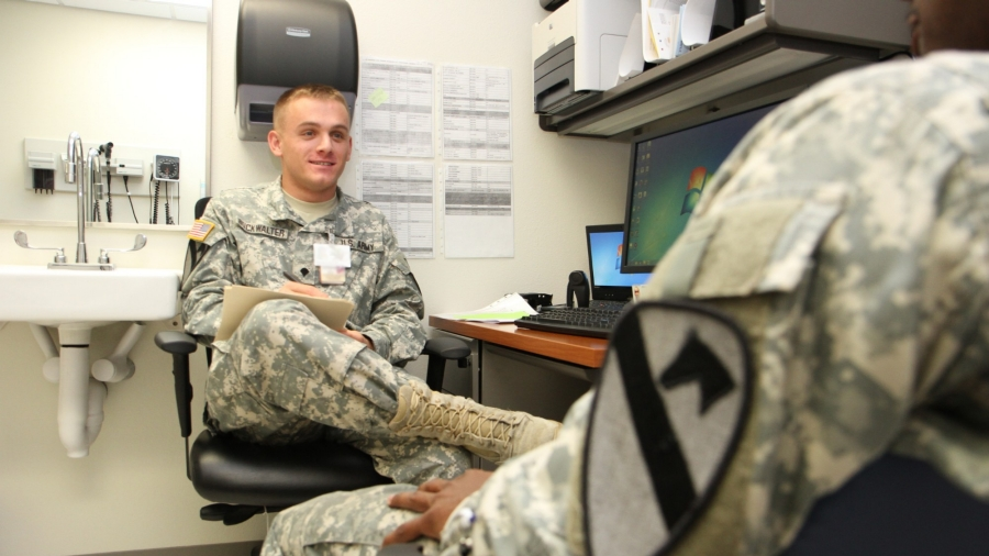 Spc. Jack Buckwalter, a mental health specialist, provides triage to a soldier during a behavioral health assessment.