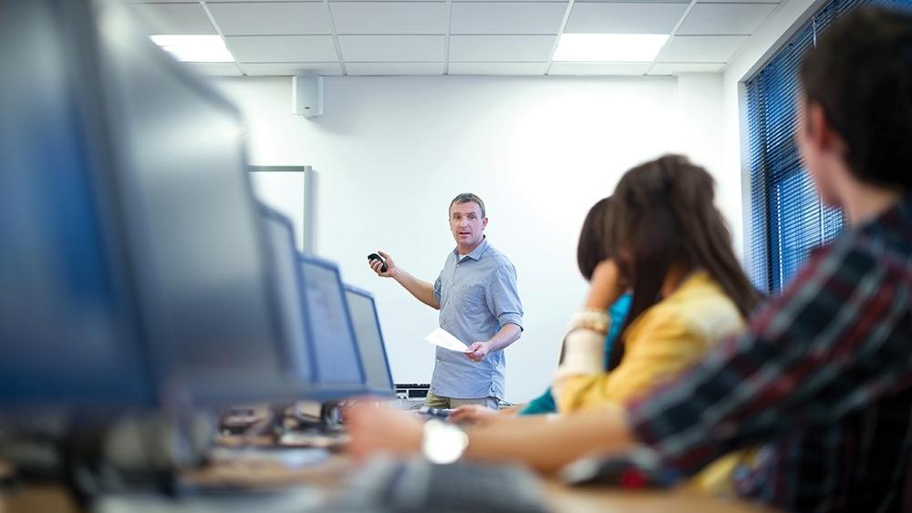 Man teaching a computer class