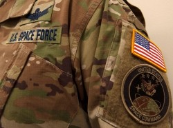 A military camouflage uniform bearing a U.S. Space Force nametape and U.S. Space Command shoulder patch, January 17, 2020, photo by U.S. Space Force/Handout via Reuters