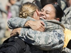 Airmen embrace after returning from deployment