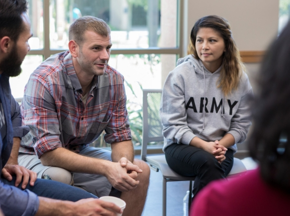 Veterans talk in a group therapy session, photo by SDI Productions/Getty Images