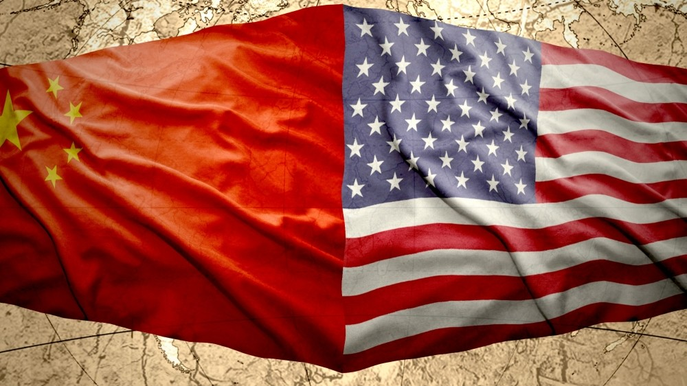 Chinese and American flags next to each other on a globe background