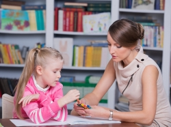 child psychologist with girl