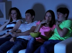 Group of teenagers watching TV