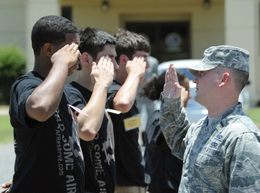 An officer demonstrates a proper salute to recruits on Barksdale Air Force Base, Louisiana, June 7, 2014