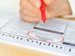 Circling job opportunities in the classified ads