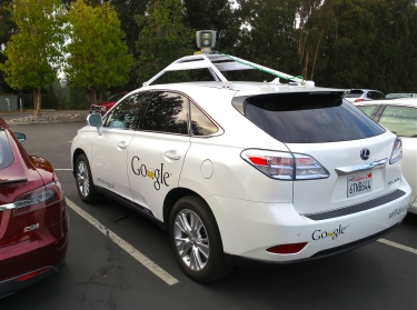 One of Google's self-driving cars picturesd in a parking lot.