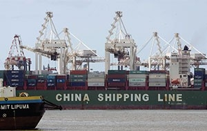 A ship from China is loaded with containers in the port in Durban, South Africa