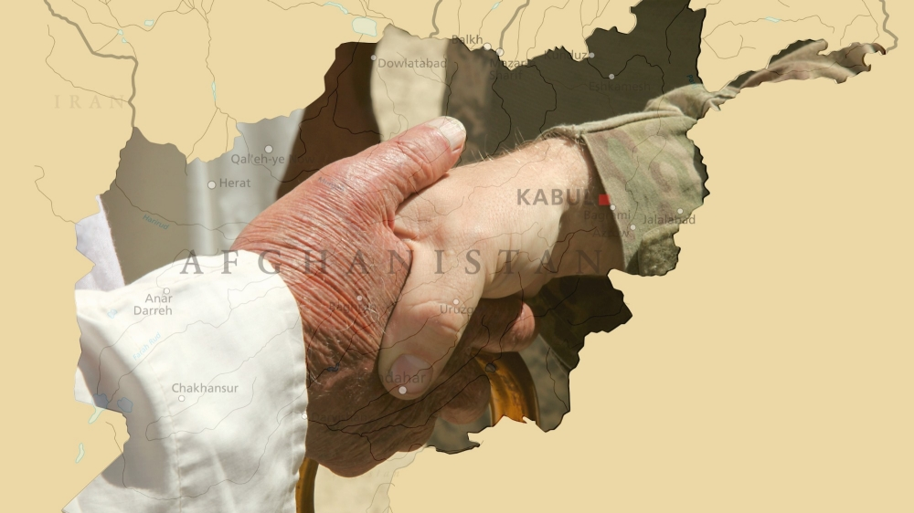 Shaking hands over map of Afghanistan