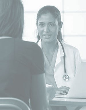 A physician speaks with a patient.