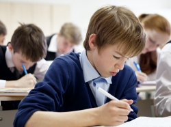 Young student taking a test in class
