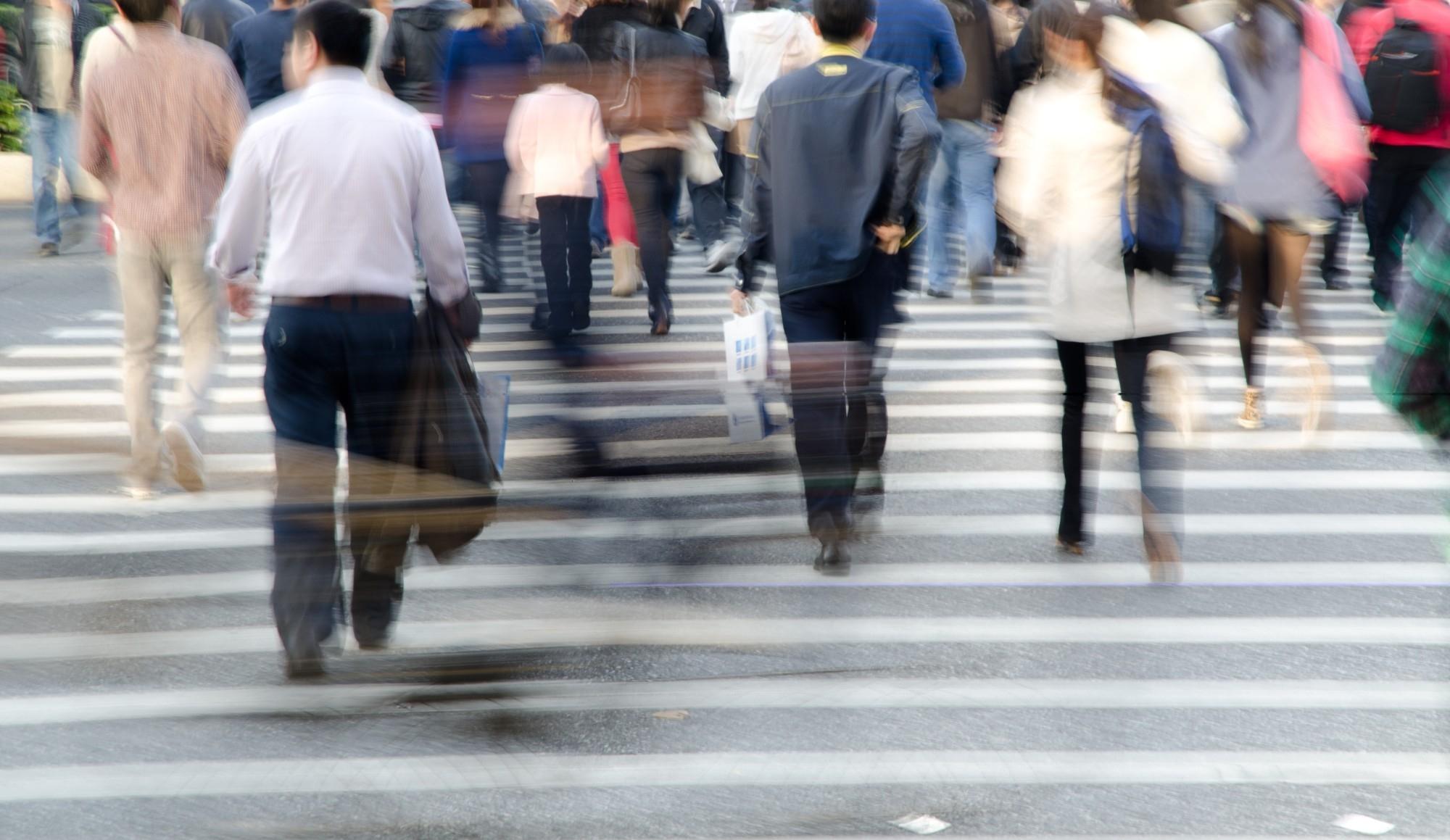 People walking on busy street.