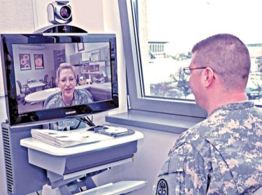 A soldier speaks to another soldier via webcam