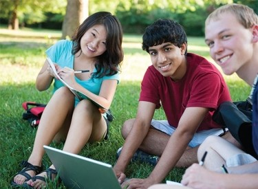 Three students study outside.