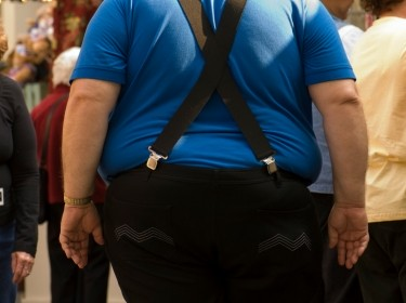 Obese man in a crowd