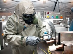 A worker engages in decontamination procedures