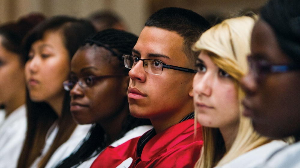 A group of students listen to a lecture