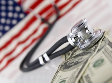 American flag, stethoscope, and money