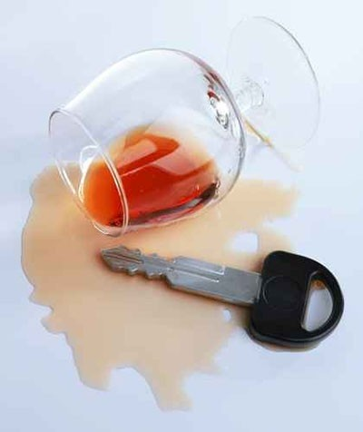 A spilled glass of cognac and car key