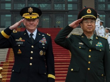 U.S. Army Gen. Martin E. Dempsey, the chairman of the Joint Chiefs of Staff, and Chinese army Gen. Fang Fenghui, China's chief of the general staff, salute during a ceremony in Beijing, April 22, 2013