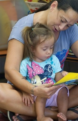 A mother reads to her daughter